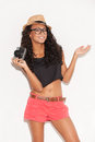 Funky girl with camera cheerful young african woman in glasses and wear holding and gesturing while standing against white Royalty Free Stock Photography