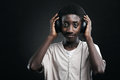 Funky teenager portrait of african teenage listening music with headphones Stock Image
