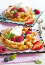 Funnel cakes with fresh berries and whipped cream Royalty Free Stock Photo