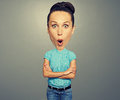 Funny amazed woman with big head over grey background Stock Photography