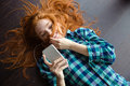 Funny amusing  girl playing with hair and listening to music Royalty Free Stock Photo