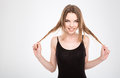Funny amusing pretty young woman playing with hair smiling natural Royalty Free Stock Photo