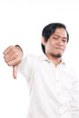 Funny Asian Man Showing Thumb Down Gesture Royalty Free Stock Photo