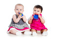 Funny babies girls with musical toys biting Royalty Free Stock Photo