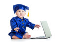 Funny baby in academician clothes with laptop girl Stock Photography