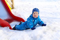 Funny baby age of months on playground outdoors in winter boy Stock Photography