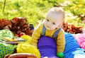 Funny baby boy in fall happy on sunny meadow Stock Photo