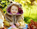 Funny baby boy in fall outdoors wearing fur costume Royalty Free Stock Photo