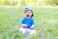 Funny baby boy is glad for summer age of months Royalty Free Stock Photos