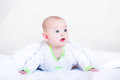 Funny baby boy playing under a white blanket Royalty Free Stock Photo