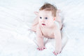 Funny baby in a diaper learning to crawl