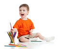 Funny baby drawing with color pencils Royalty Free Stock Photo