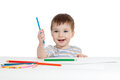 Funny baby drawing with color pencils Royalty Free Stock Photos