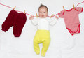Funny baby girl on clothesline Stock Image
