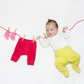 Funny baby girl on clothesline Stock Photos