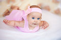 Funny baby girl in a pink dress Stock Image