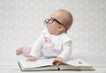 Funny baby girl reading a book Royalty Free Stock Photo
