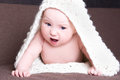 Funny baby girl in white woolen scarf crawling beautiful Royalty Free Stock Image