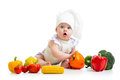 Funny baby with healthy food vegetables cook Stock Image