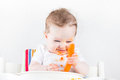 Funny baby trying vegetablet for the first time Royalty Free Stock Photo