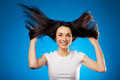 Funny beautiful brunette girl holding her long hair up Stock Photography