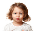 Funny beautiful kid making grimace isolated on white Royalty Free Stock Images