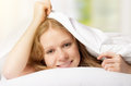 Funny beautiful woman under the blanket Stock Photos
