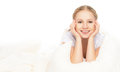 Funny beautiful young blond woman under the blanket in bedroom Royalty Free Stock Photos