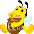 Funny bee cartoon with honey illustration of Stock Images