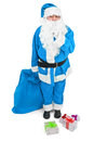 Funny blue santa asks to be quiet over white background Stock Photos