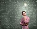 Funny botanist young man in glasses against chalkboard with sketches Stock Photography