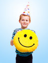 Funny boy in birthday cap on blue background Stock Photos