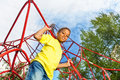 Funny boy holds and stands on red ropes Royalty Free Stock Photo