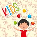 Funny boy kid playing colored balls