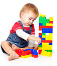 A funny boy is playing with lego Stock Photography