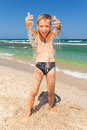 Funny boy playing with sand on the beach Royalty Free Stock Photo