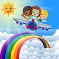 Funny boy riding plane over rainbow