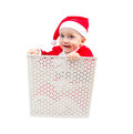 Funny boy in santa clause suit hiding in a box photo of surprised isolated on white background Stock Photo