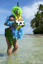 Funny brazilian soccer fan on beach fondling her balls tropical Royalty Free Stock Image