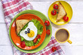 Funny Breakfast with bear-shaped fried egg, toast, cherry tomato Royalty Free Stock Photo