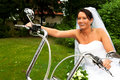 Funny bride well know as bride chick laughing sitting harley davidson bike her wedding ceremony Royalty Free Stock Image