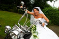 Funny bride well know as bride chick laughing sitting harley davidson bike her wedding ceremony Stock Photos