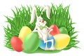 Funny bunny rabbit with colorful Easter eggs Royalty Free Stock Photo