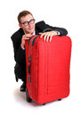 Funny business man behind red luggage Royalty Free Stock Photo