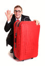 Funny business man hide behind red luggage Royalty Free Stock Photo