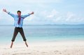 Funny business man jumping on the beach Royalty Free Stock Photo