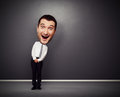 Funny businessman with big head full length picture of over dark background Royalty Free Stock Photography