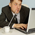 Funny businessman drinking coffee and working Stock Photography