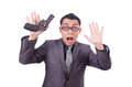 Funny businessman with gun on white Stock Photo