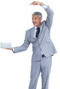 Funny businessman holding gift in right hand on white background Stock Image